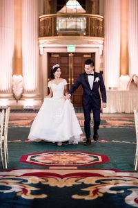 Devina & Andy march in into romantic wedding banquet