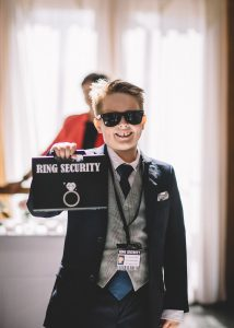 The youngest guest at the wedding as the ring bearer – ring security officer in this case!