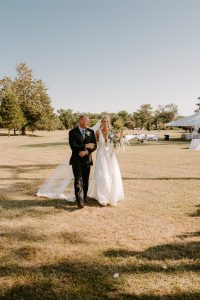 Remington walking down the aisle with her father