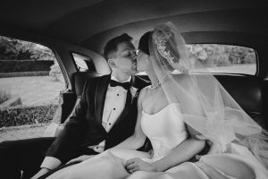 bride & groom kissing in the car