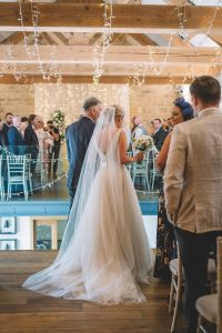Hollie's father walking her down the aisle
