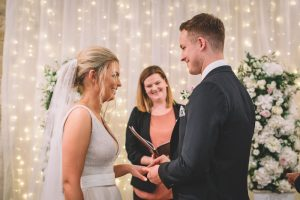 Hollie and Richard exchanging rings