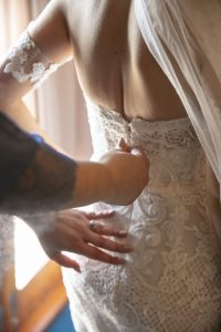 Sam fitting onto her wedding gown