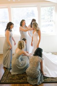 Tatiana Fitting into her wedding gown
