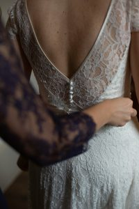 Melissa fitting into her wedding gown