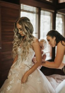 stacey fitting into her wedding dress